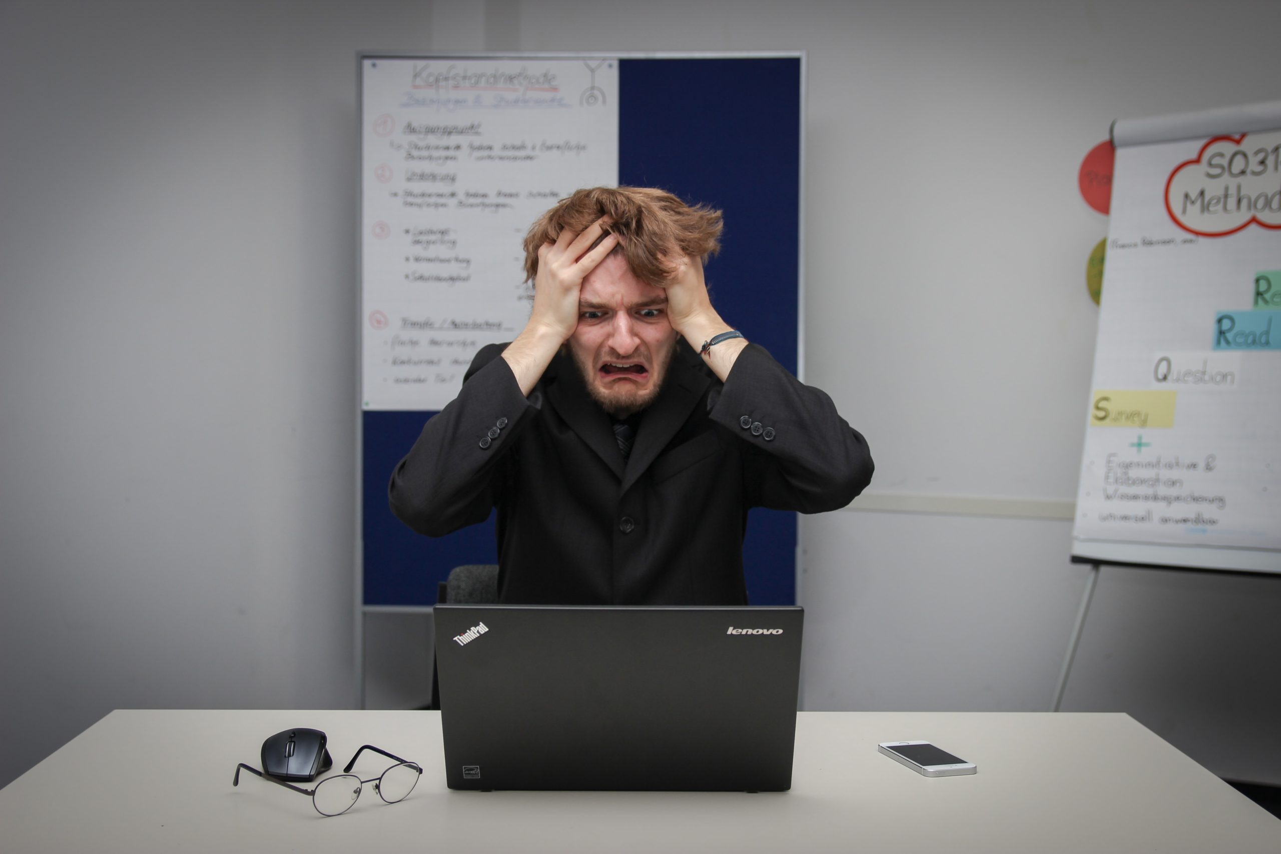 person at computer looking stressed and frustrated
