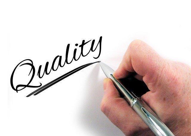 quality written in pen on paper