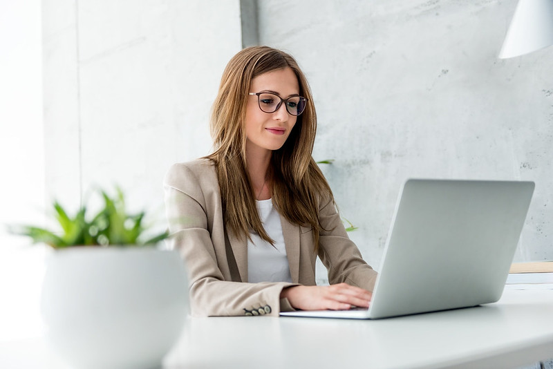 woman sitting at desk on a laptop