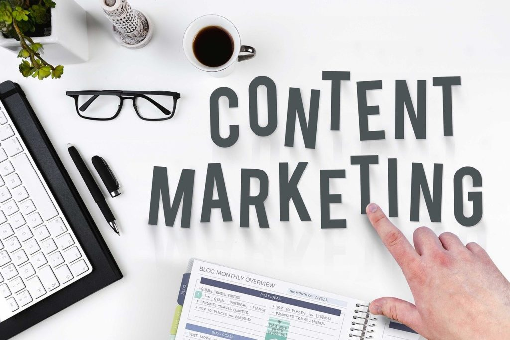 Content Marketing Graphic with a coffee cup, a planner, eyeglasses and a pen