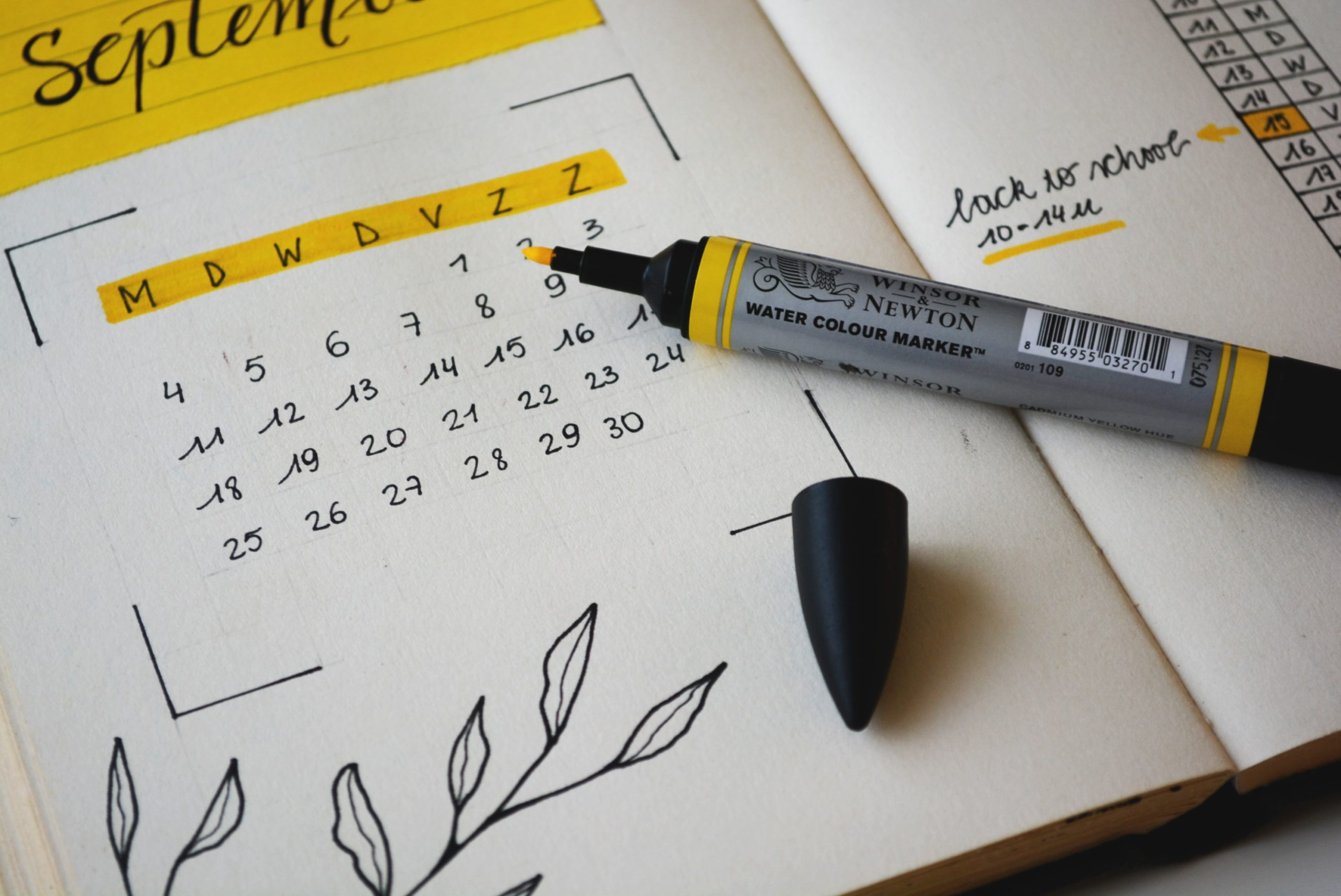 hand-drawn calendar with highlighter and drawing