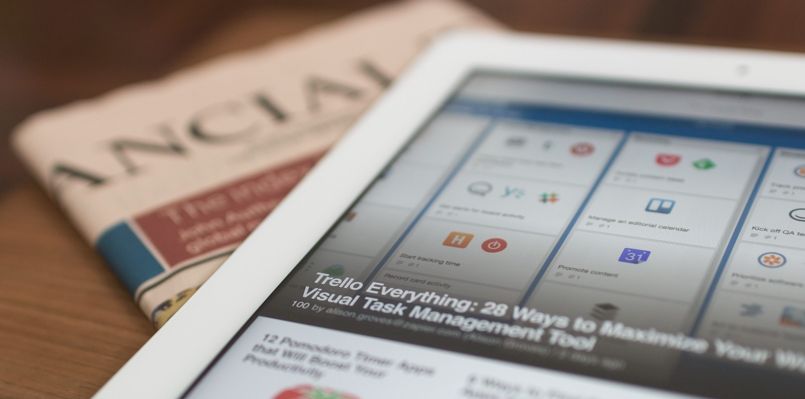 newspaper and iPad open to online articles