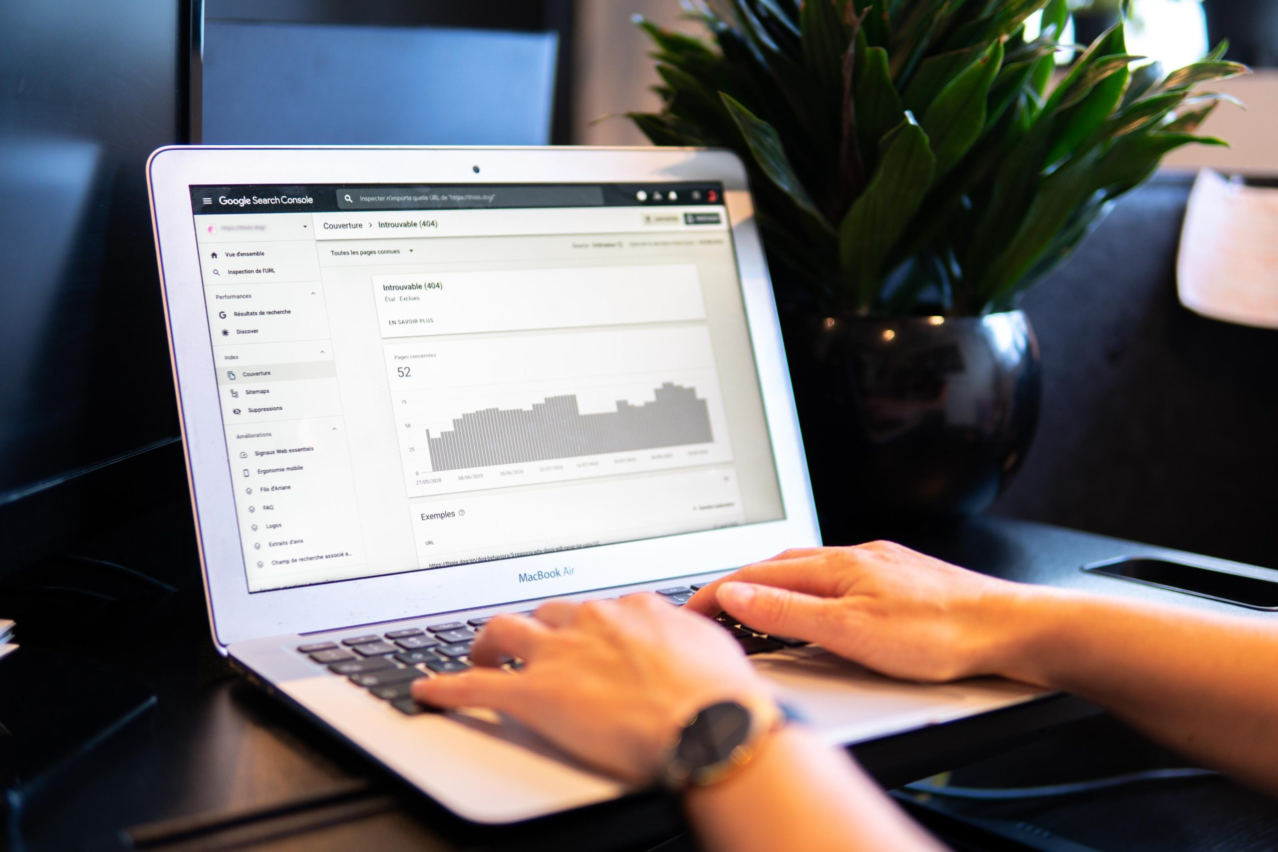 hands typing while on an analytics screen
