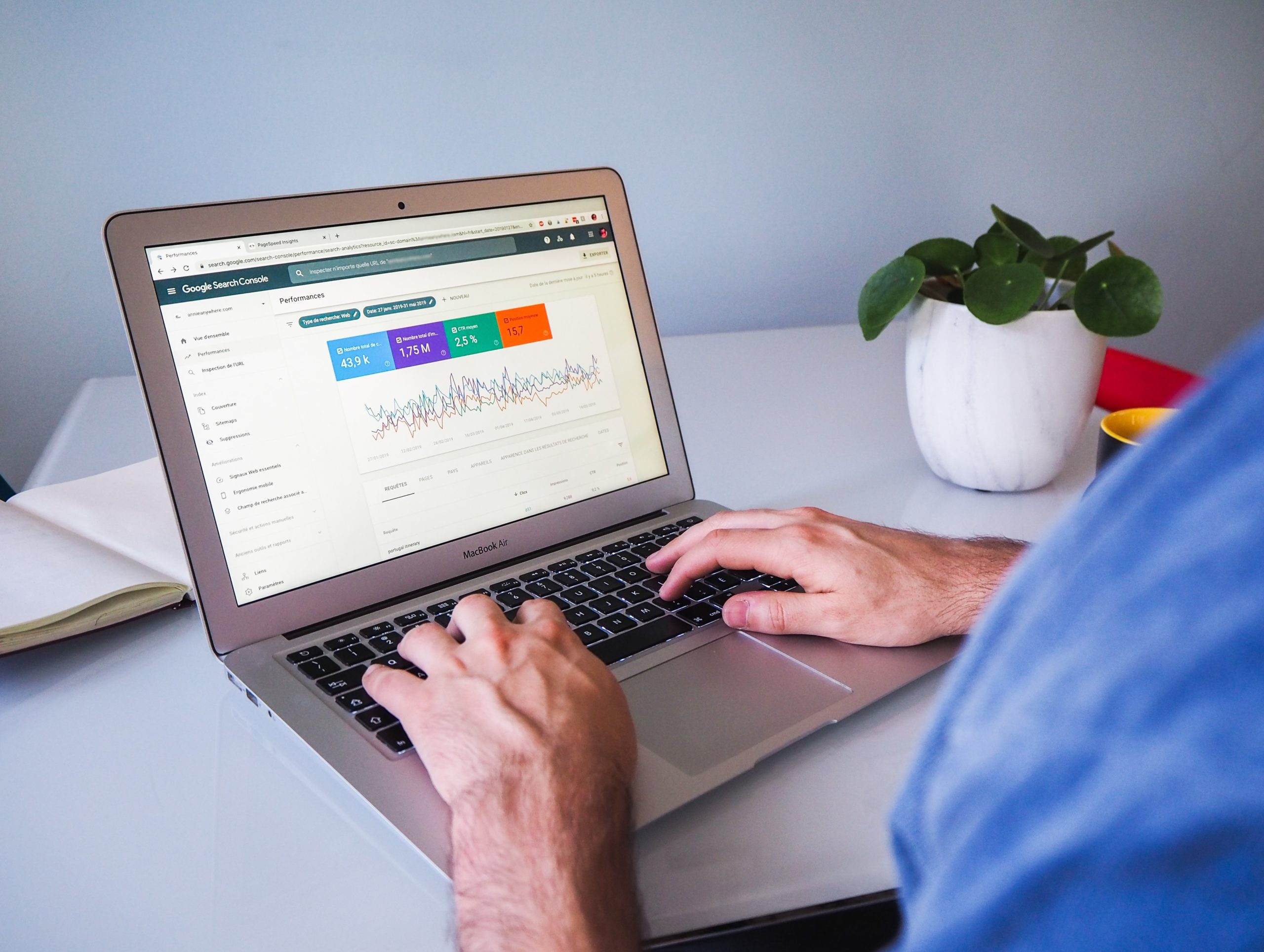 hands typing on laptop with google analytics screen
