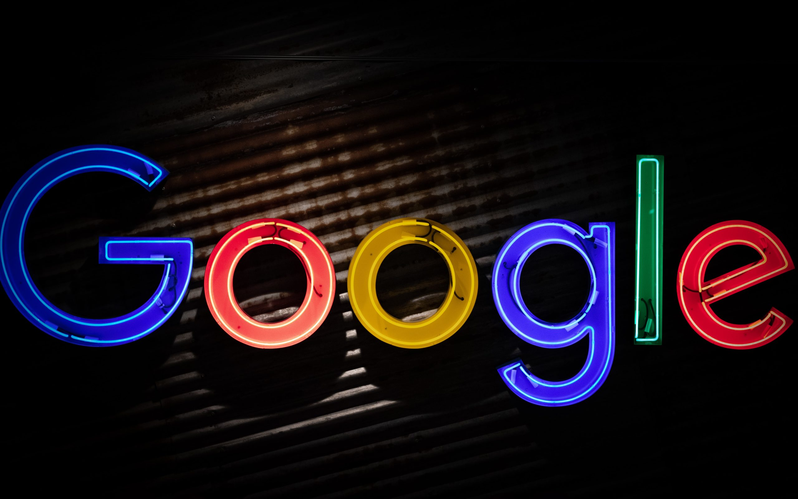 neon sign that reads google