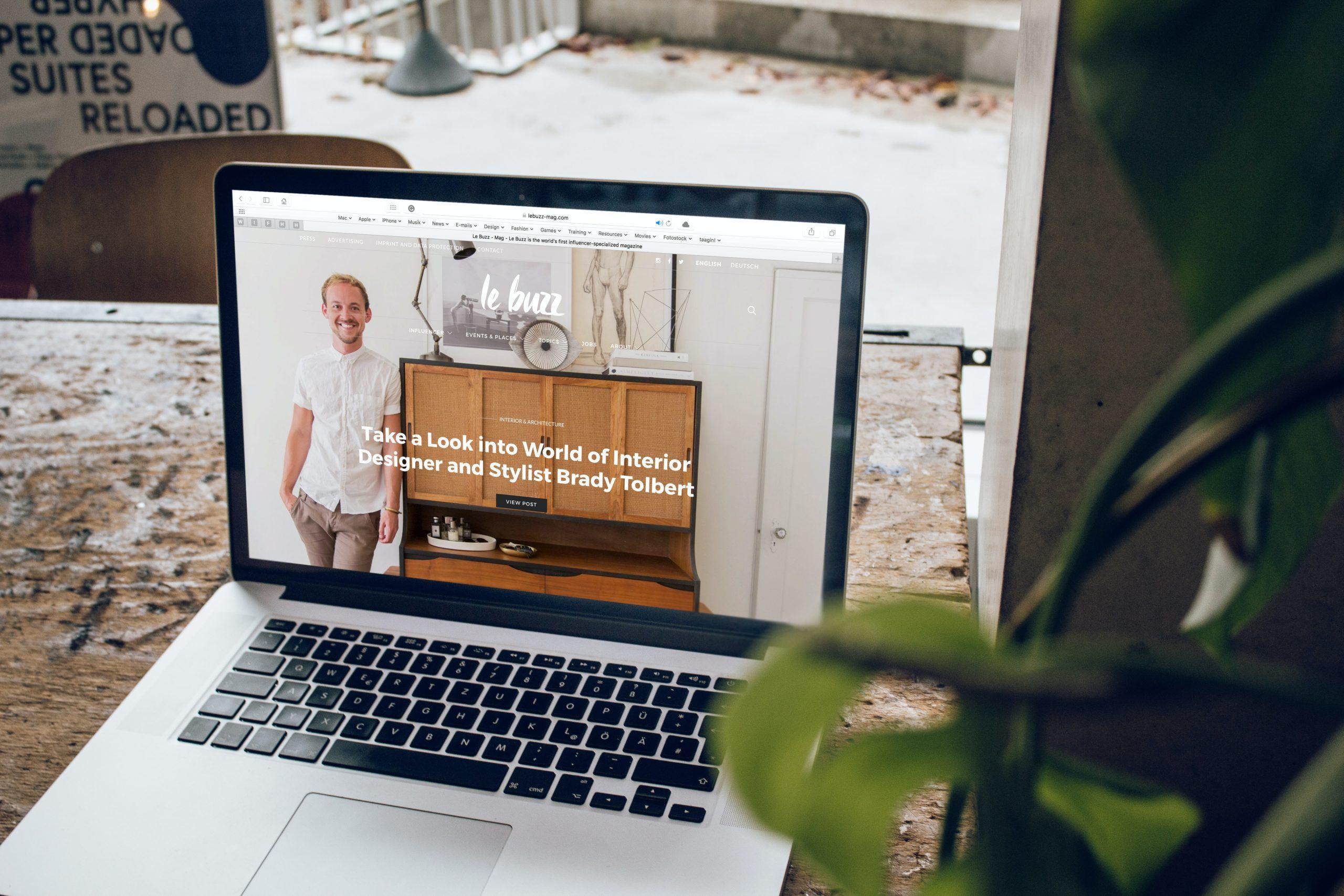 macbook pro on top of brown wooden table